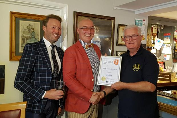 Paul Cooke (left)  and James Burrell (centre) being presented their award by chairman of CAMRA's Maldon and Dengie branch Chris Harvey