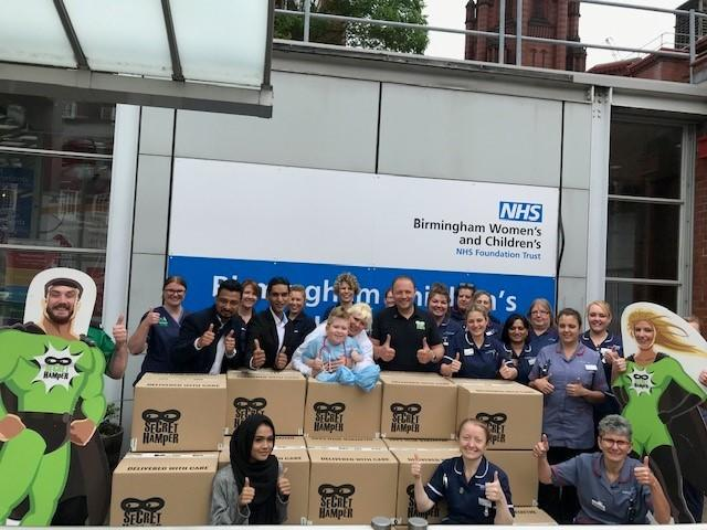 NHS staff with Nigel and Noah at Birmingham Children's hospital