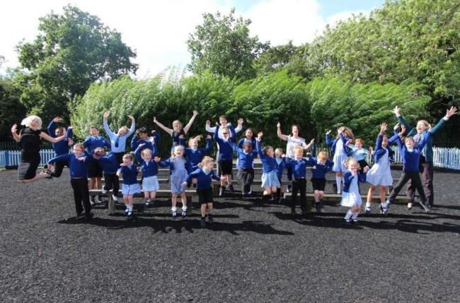 Celebrations - staff and pupils celebrate their Ofsted success after inspectors rate the school as Good