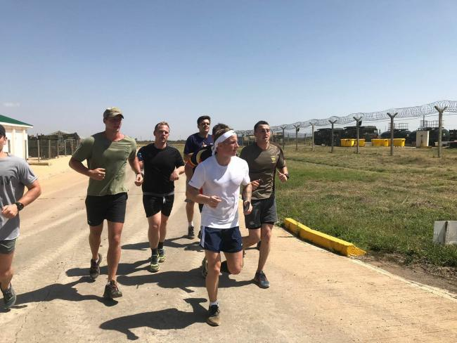 MARATHON: Toby Newman running with fellow soldiers at their base in Kenya