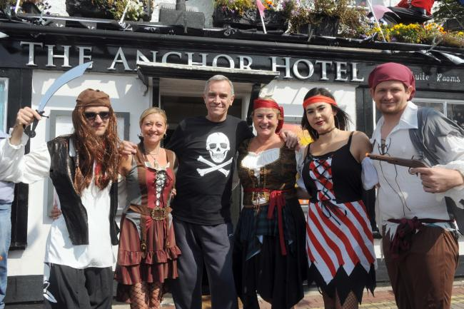 AHOY, ME HEARTIES: Anchor Hotel staff dressed up at last year's Quay Day. The event returns to Burnham on Bank Holiday Monday