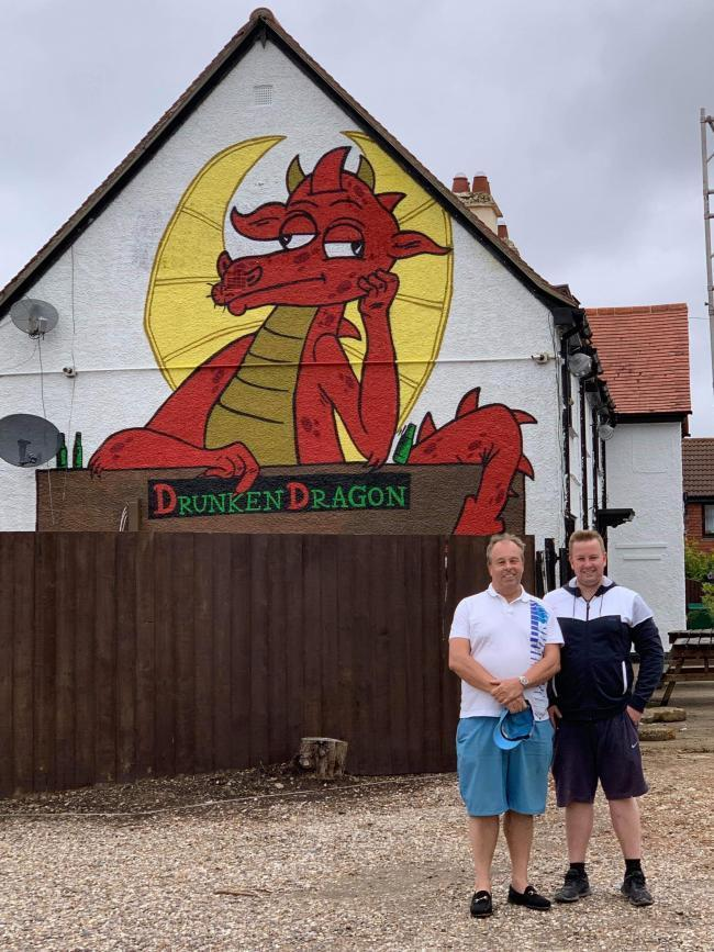 SAVE OUR DRAGON: New pub owner Ben Davies (right) with dad Dave and the Drunken Dragon mural, and (inset) Frank BrunoMain picture: Dave Davies