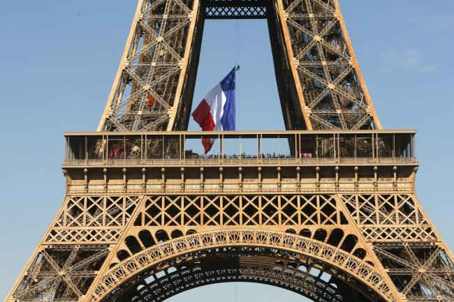 Firefighters unfurled a huge French flag from the Eiffel Tower