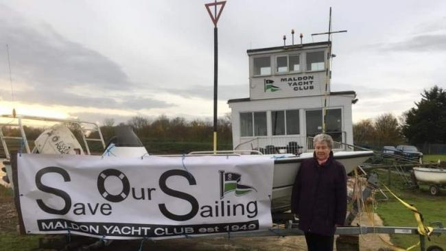 SOS CALL: Maldon Yacht Club commodore Pat White with the Save Our Sailing banner