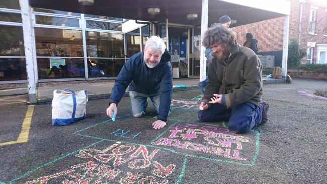 Action - artist James Dodds (left) joins in the chalking outside Wivenhoe Library	 		                 Picture: Jo Wheatley
