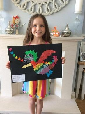 Ava Clark with her winning artwork