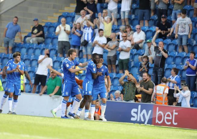 Celebration time - Colchester United's players celebrate scoring in front of the South Stand Picture: STEVE BRADING