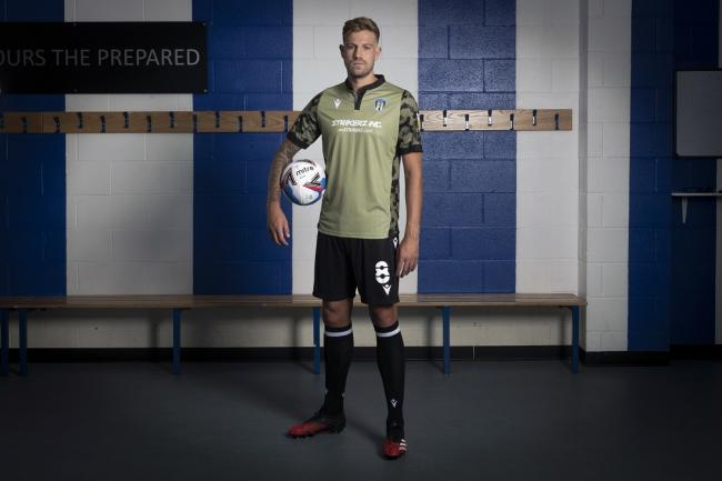Dressed for success - Colchester United midfielder Harry Pell models the club's new away strip for the 2020-21 season Picture: RICHARD BLAXALL