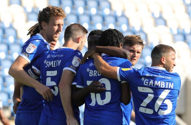 All together now - Colchester United's player celebrate scoring their opener against Bolton Wanderers Picture: STEVE BRADING