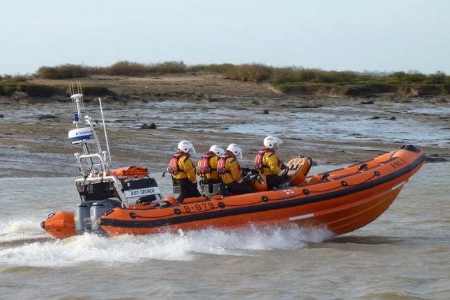 Lifeboat volunteers save woman trapped in mud up to her waist