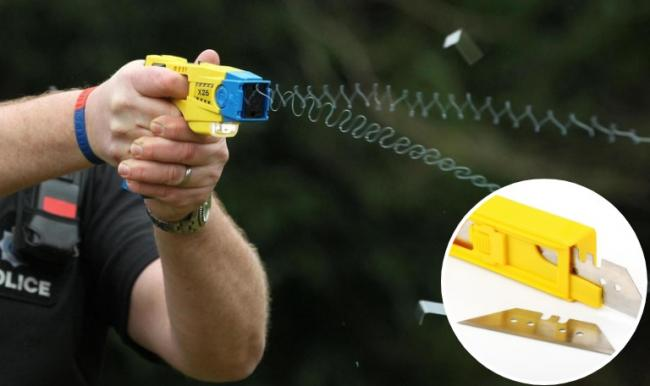 Stock image of a taser and razor