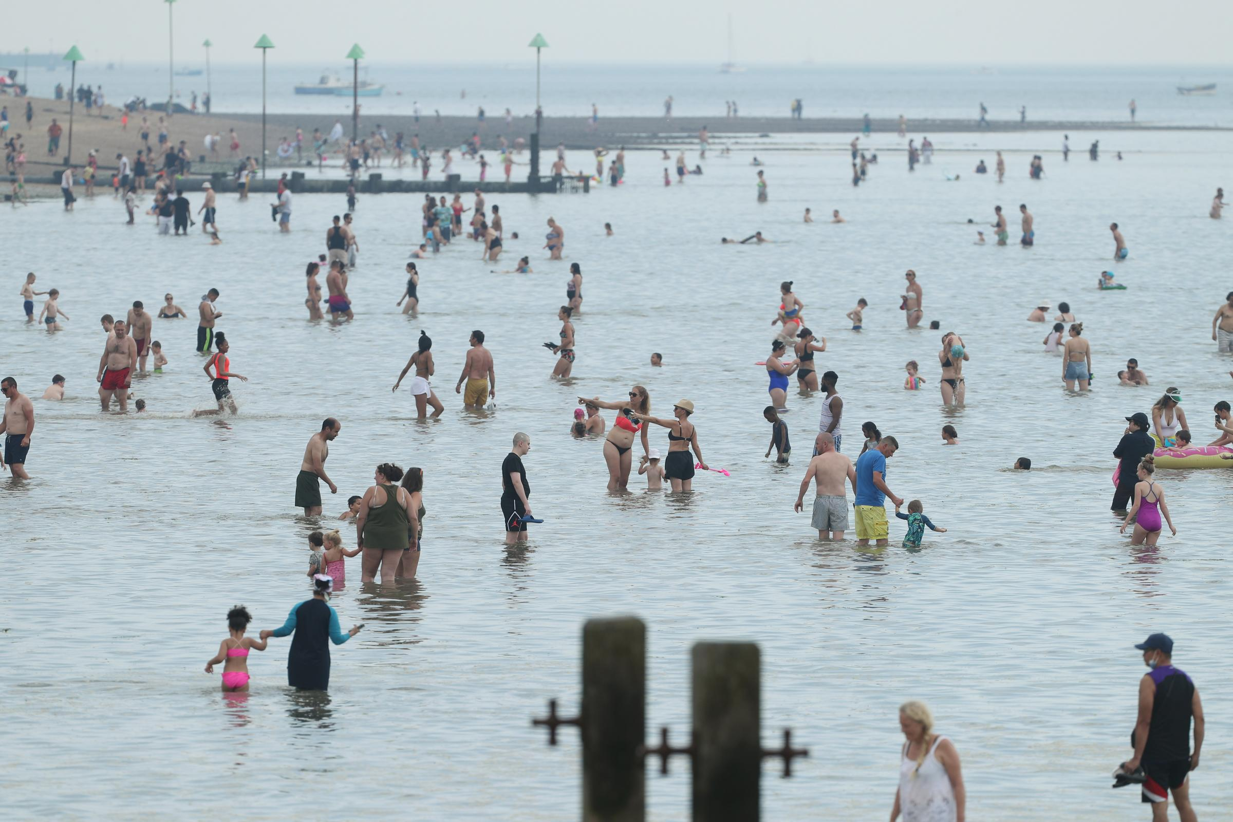People enjoy the hot weather at Southend beach