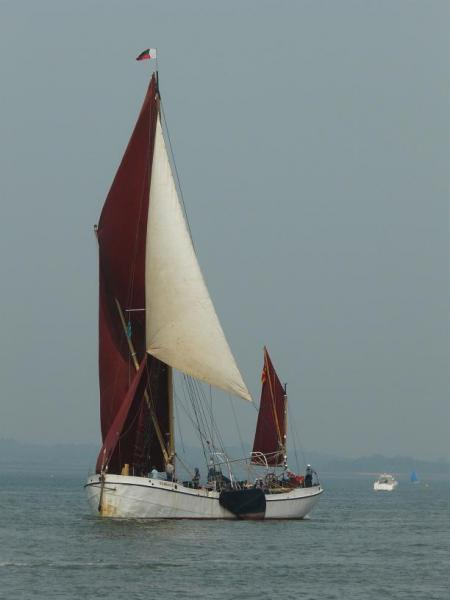 Maldon barge Reminder sailing across the finish line to win four trophies.