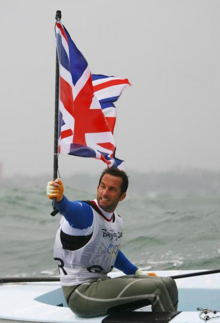 Three-time Olympic gold medallist Ben Ainslie will be the first Torchbearer to carry the Olympic Flame in the UK.