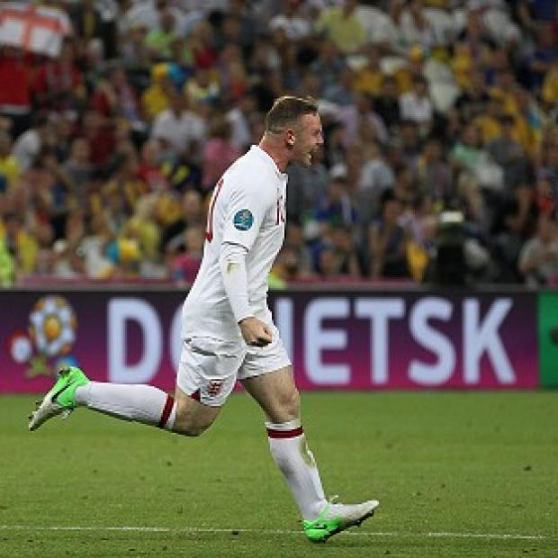 Wayne Rooney celebrates scoring the winner against Ukraine