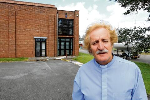 Rev. Dr. Jon Morgan in front of the squash courts he wants to change into a performing arts centre