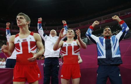 Team GB celebrates winning the silver medal at the Artistic Gymnastic men's team final - only to be relegated to bronze after an appeal by Japan...Still a major achievement!
