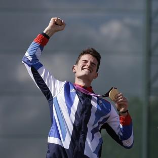 Great Britain's Peter Wilson reacts after receiving the gold medal for men's double trap event at the 2012 Summer Olympics (AP)