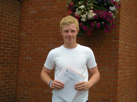 Plume School pupil Chris Harris with his results.