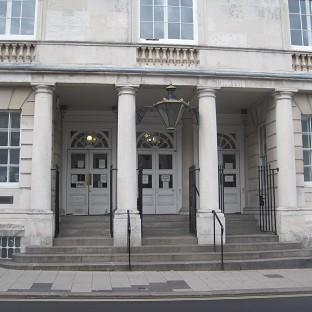 Spencer Brown was jailed at Lewes Crown Court over dog attacks which left victims 'savagely mauled'