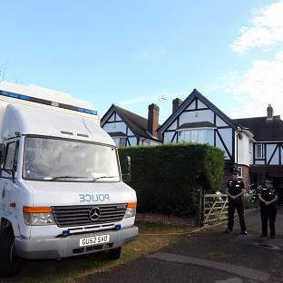 Surrey Police outside the home of Saad Al-Hilli in Claygate