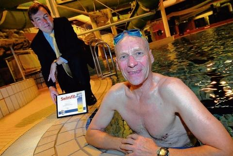 Tony Shrimpton was awarded a certificate for swimming 5,000 miles by John Whittingdale MP in 2007