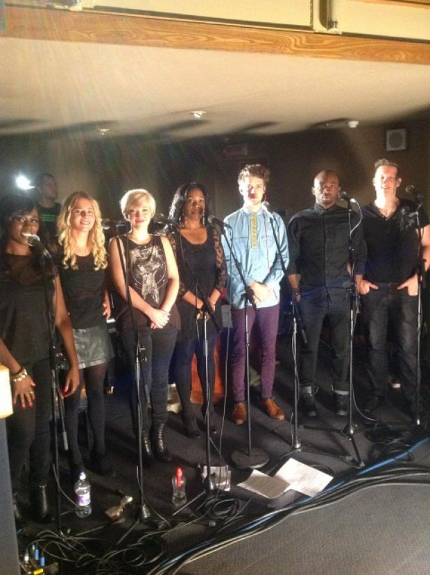 Jon Rattenbury, far right, singing in the Live Lounge with other backing singers