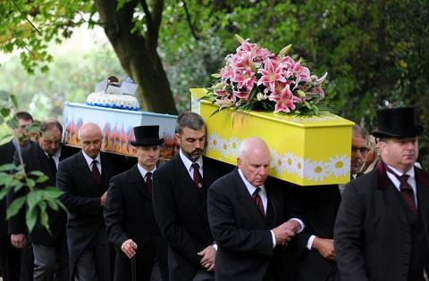 The coffins of Abbey and Brad are carried into their funeral service at St Mary's Church, Woodham Ferrers