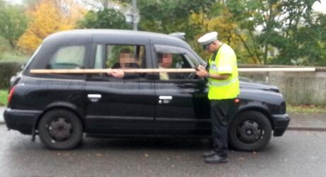 """Jousting"" taxi stopped by police in road crackdown"