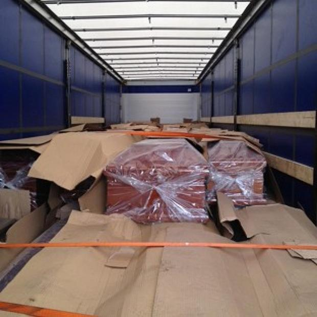 Three people hid themselves among dozens of boxed coffins heading to the UK in a van from Bulgaria