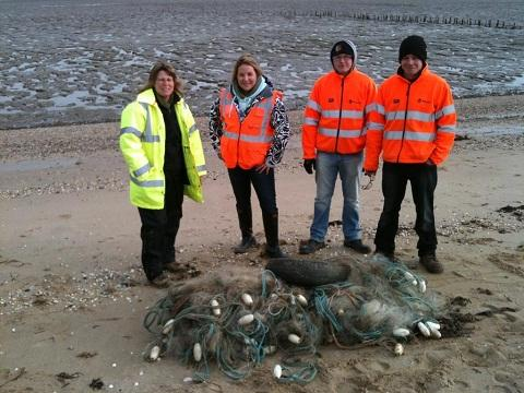 Four of the volunteers with the fishing net they discovered