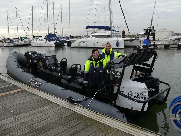 PCSOs Hayley Toye (left) and Karen Garwood with a security cover fitted to an outboard motor on a marine unit RIB.