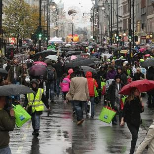 Shoppers during the American Express Shop West End VIP Day enjoy a traffic-free Oxford and Regent Streets in central London