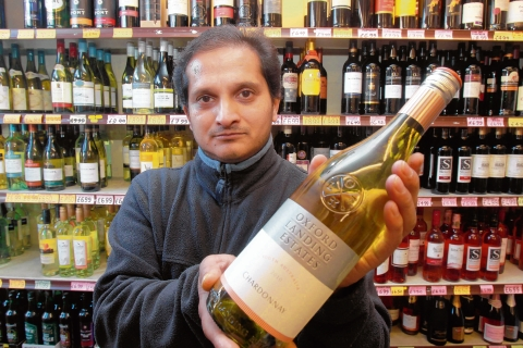 Off licence owner, Mash Patel, is concerned about the new minimum alcohol price plans