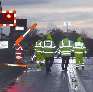Police at a railway crossing near the village of Blaxton, north Nottinghamshire, where a girl sustained fatal injuries