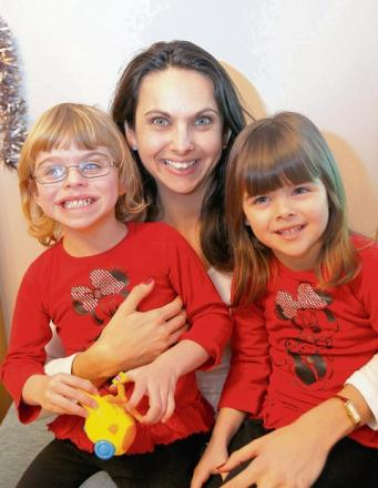Caroline Stannard, with twins Amy and Abigale, 4.