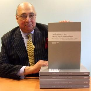 Sir Desmond de Silva with his Report of the Patrick Finucane Review