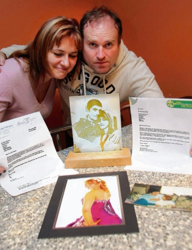 Abbey's parents, Louise and Stewart Parker, with the donation letters