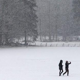 Walkers in the Scottish Borders as heavy snow hits areas around Scotland