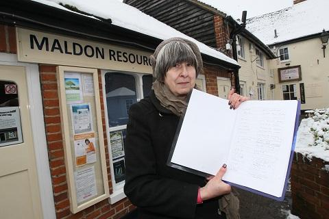 Volunteer Sue Roberts with the petition
