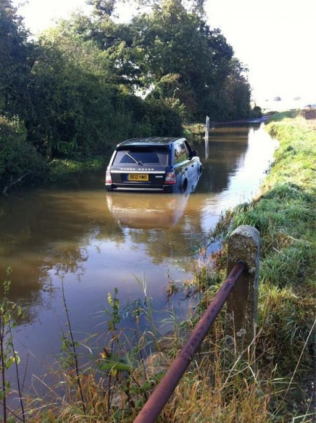 Barrie and Tony Drewitt-Barlow's car that became submerged in flood water