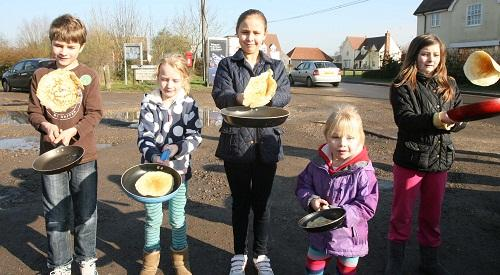 Little Totham: Villagers stage pancake race in the sunshine