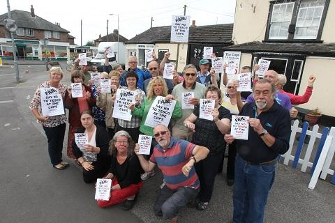 Campaigners with 'Say no to Tesco' posters outside the proposed Tesco Express site in Wantz Road