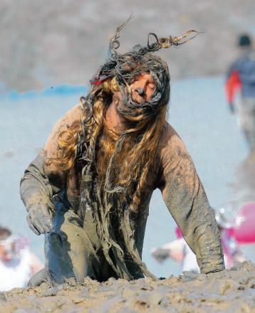A competitor braves the mud last year