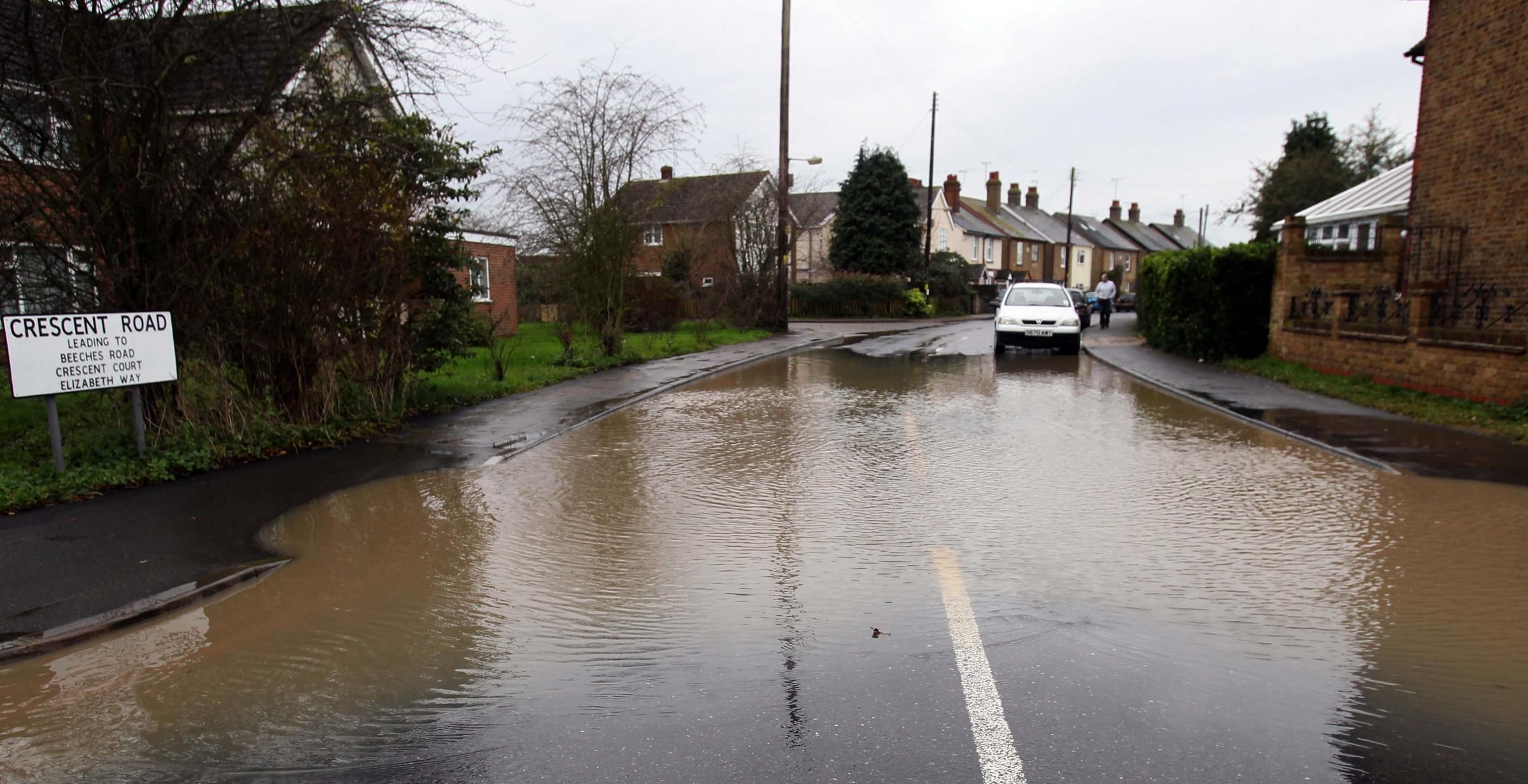 Flooding in Holloway Road, Heybridge, on Christmas eve. There are plans to build hundreds of homes on fields behind the street.
