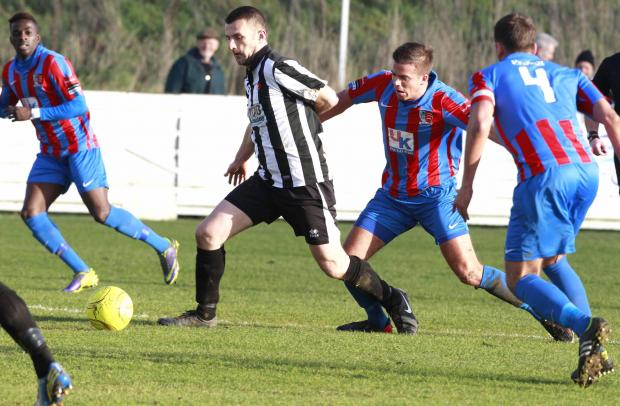 Maldon and Tiptree FC in the blue and red shirts in action against Heybridge Swifts on Boxing Day