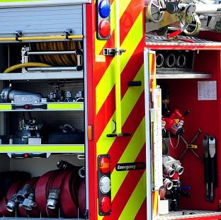 Firefighters and police found the body of an elderly woman at a building which had partially collapsed after a fire
