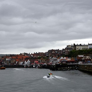 Whitby in North Yorkshire, where two bodies have been found on a boat moored in the harbour. Police say there are not believed to be any suspicious circumstances.