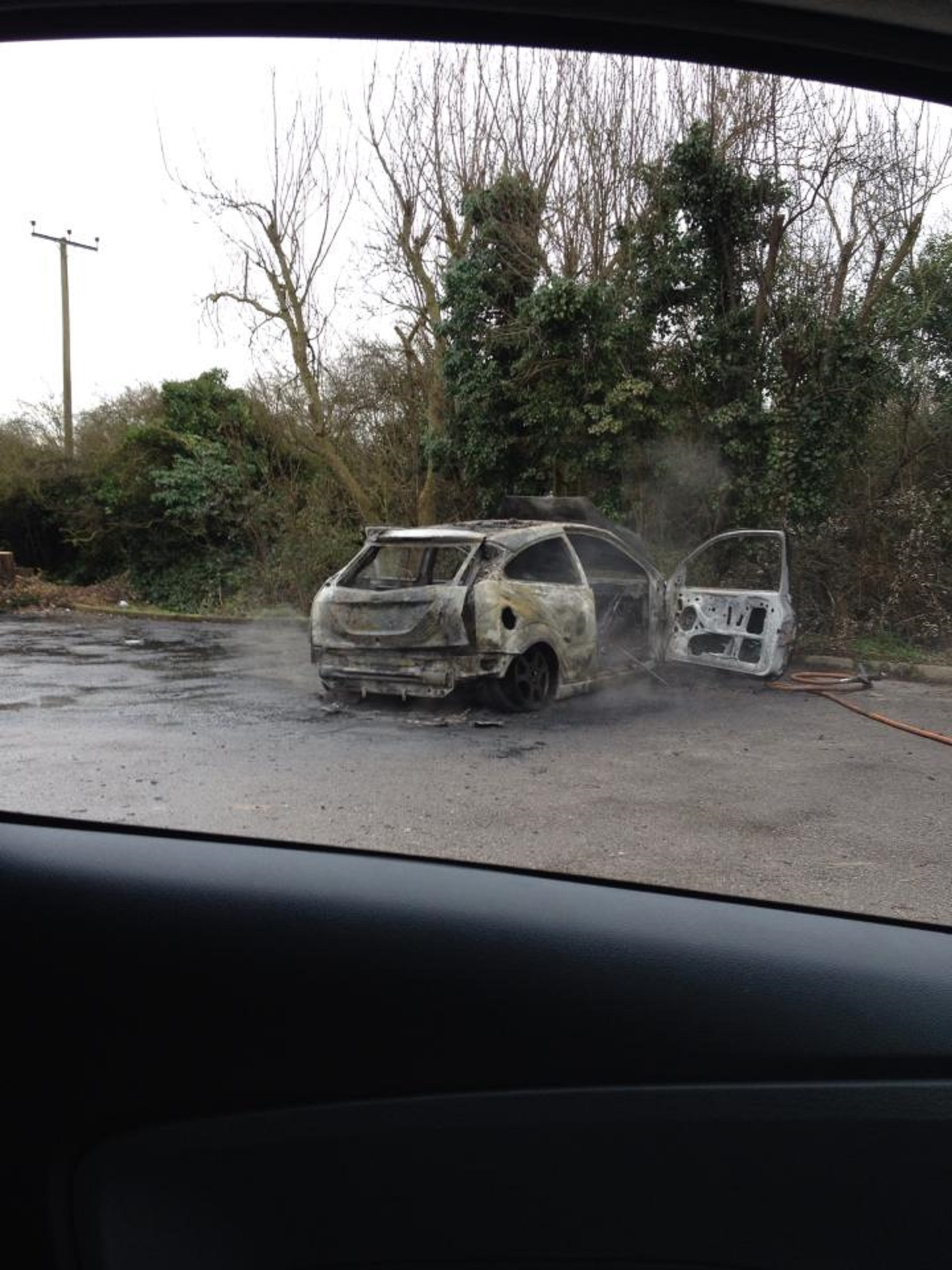 The burned out car. Submit