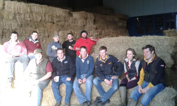Members of Southminster Young Farmers Club taking a break from loading lorries with hay